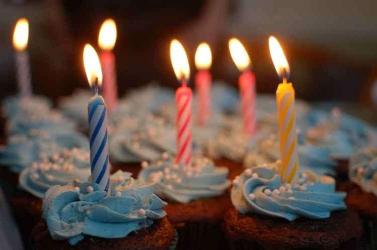 lighted candles on cupcakes